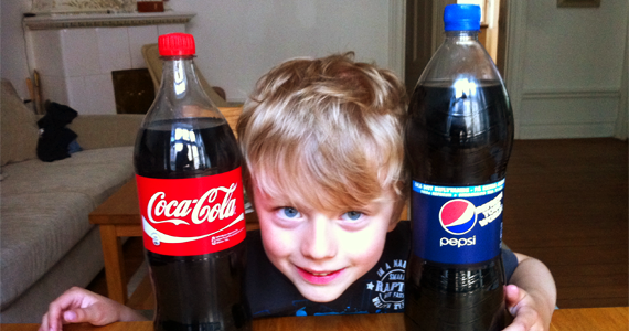 Coca Cola, Pepsi Cola and a child